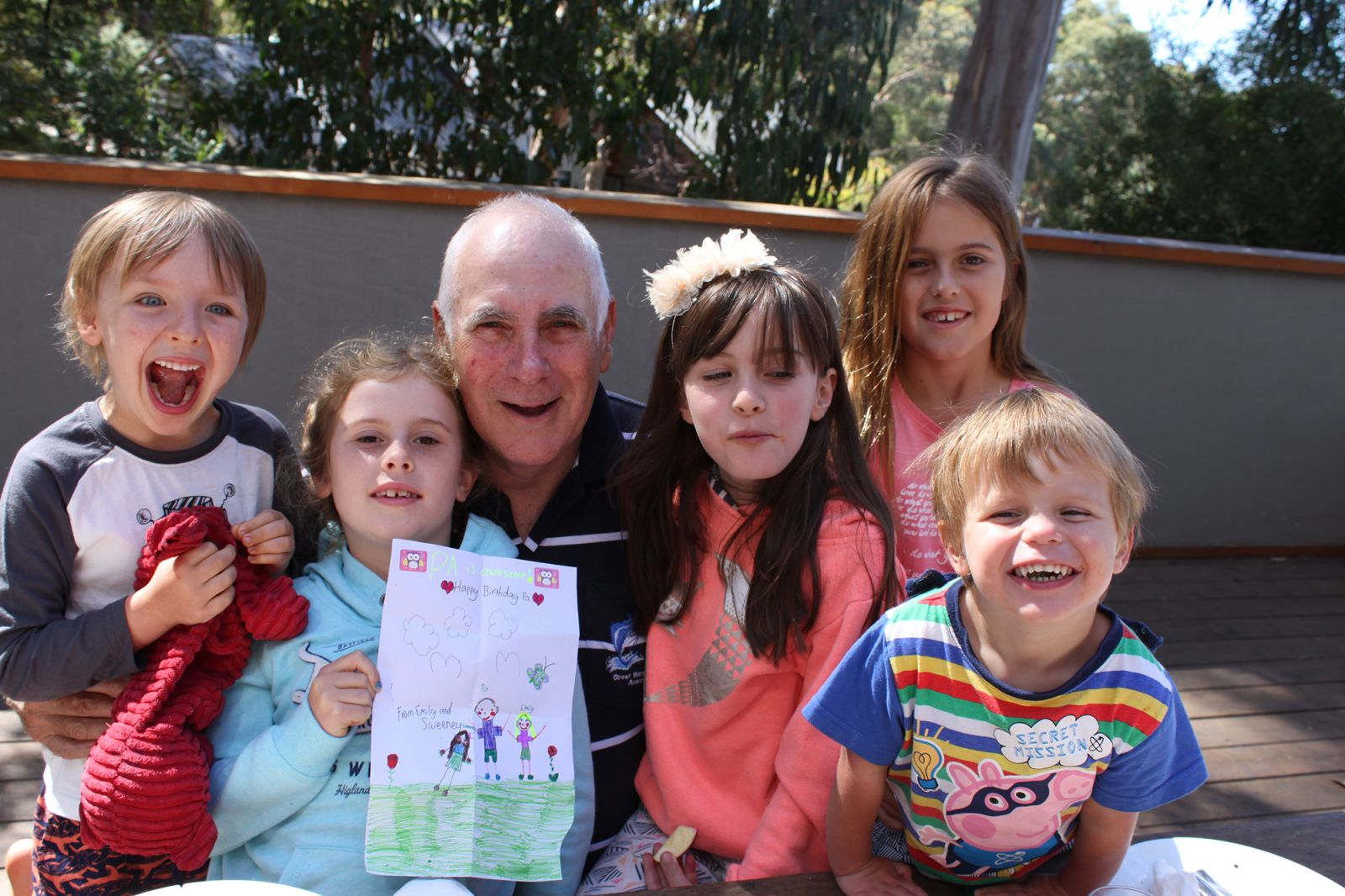 John in Retirement with grandchildren